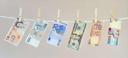 Money laundering concept, banknotes hanging on washing line photo
