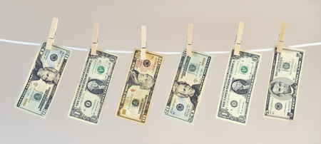 Money laundering concept, US banknotes hanging on washing line photo