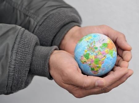 Globe in asian mans hands Stock fotó