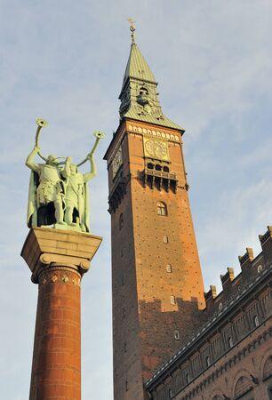 clocktower: Lure blowers statue and city hall clocktower, Copenhagen, Denmark  Stock Photo