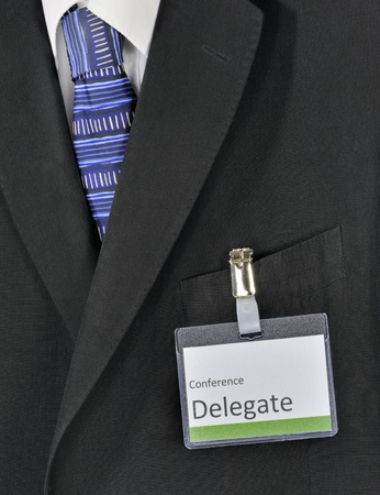 delegate: Closeup on male business suit and conference delegate badge Stock Photo