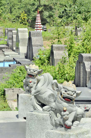 hotel indonesia: Ornate gravestones in graveyard known as the chinese hotel in Senggigi, Lombok, Indonesia Stock Photo