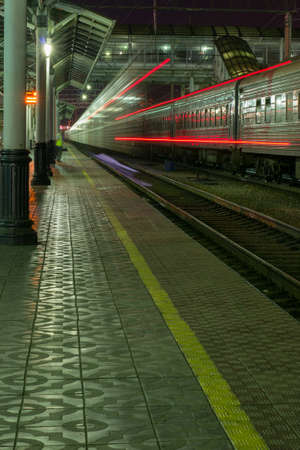 peron: trainleaving Peron train with night lights Stock Photo
