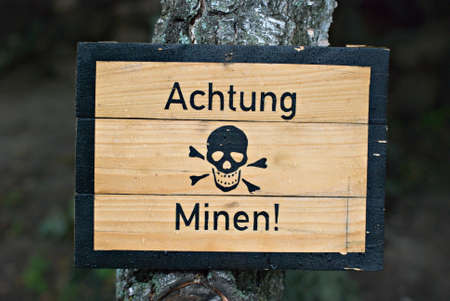German land mines warning sign from World War Two, wet with water droplets  Stock Photo