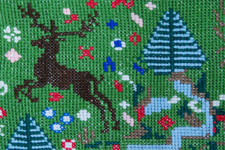 Vintage cross stitch pattern with deer  photo