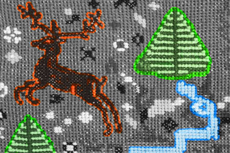 Vintage cross stitch pattern with orange deer  Desaturated and toned  photo