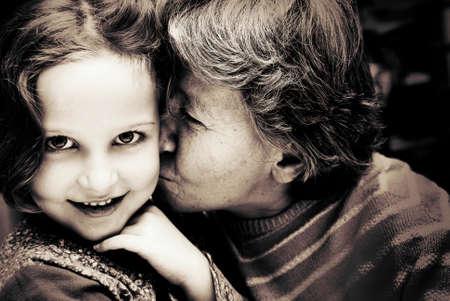 Portrait of Grandmother kissing her granddaughter  Banque d'images