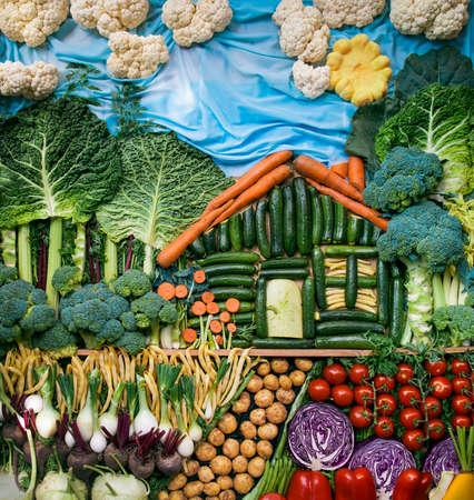모듬 유기농 야채로 만든 크리 에이 티브 풍경입니다. 스톡 콘텐츠