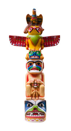 Colorful totem pole. Isolated on white background. Path included.