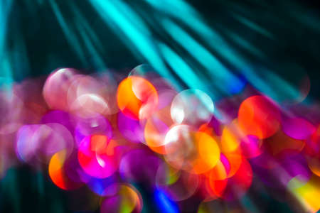 Glitter abstract background with bokeh defocused with natural sun rays. Stock Photo