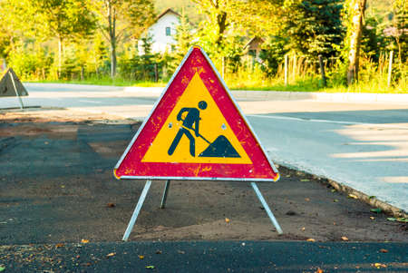 Works ahead warning sign on a road. Stock Photo - 65610603