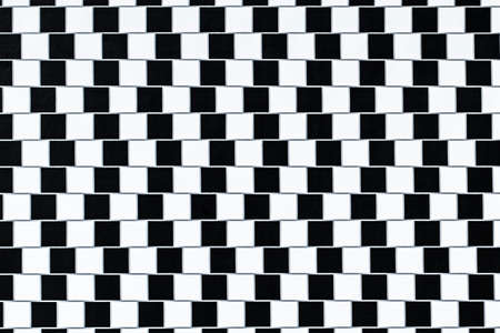 perceived: Lines are parallel but seem to be slanted - optical illusion.