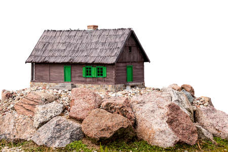 Model of cottage on rocks isolated on a white background.