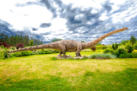Sculpture of dinosaur ( Sauropoda , Diplodocus ) in live size. Stock Photo