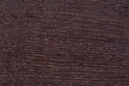 Texture of brown wenge veneer. Stock Photo