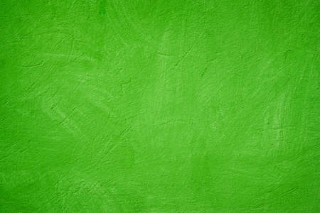 A green colored old wall texture background.