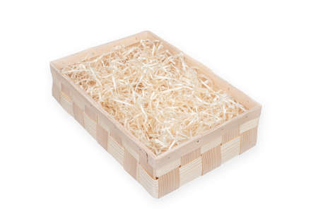 Wooden box for eco gift filled with decorative shredded white paperstraw. Isolated on white. Clipping path included. Reklamní fotografie