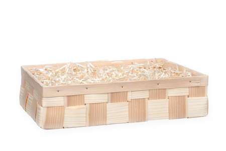 Wooden box for eco gift filled with decorative shredded white paperstraw. Isolated on white.