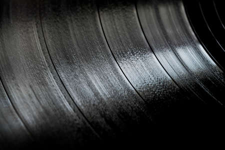 Surface of an old vinyl record. Macro shot, shallow depth of field. SDF.