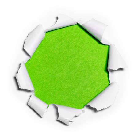 Paper hole in white paper with ragged edges with green background.