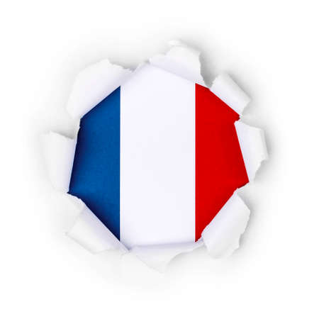View of the french flag through the big breakthrough in the paper. Zdjęcie Seryjne