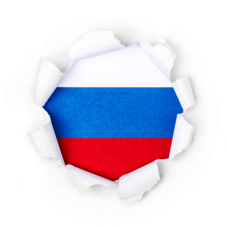 View of the russian flag through the big breakthrough in the paper.