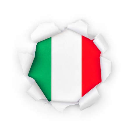View of the italian flag through the big breakthrough in the paper.
