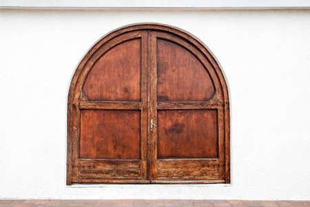 Old wooden massive door on building. 写真素材