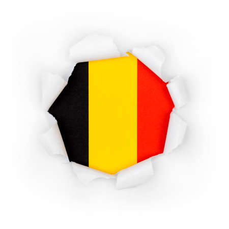 View of the belgian flag through the big breakthrough in the paper.