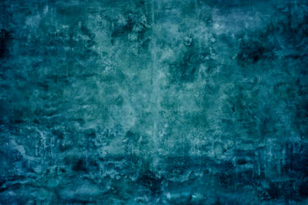 Grunge blue painted cement wall texture background.