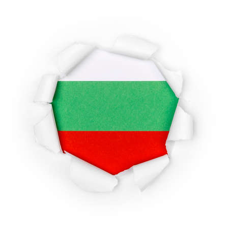 View of the bulgarian flag through the big breakthrough in the paper.