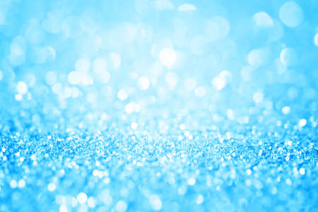 Blue glitter abstract background with bokeh defocused. Macro shot.
