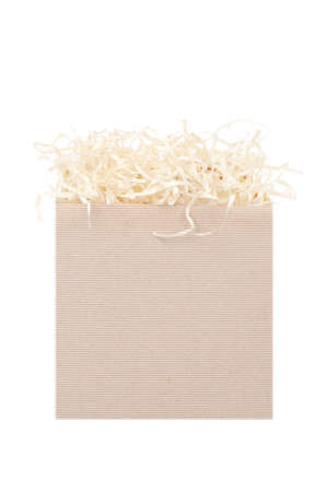 Cardboard box for eco gift filled with decorative shredded white paperstraw. Isolated on white.