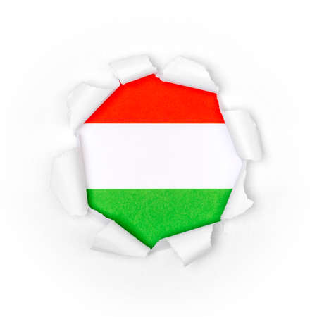 View of the hungarian flag through the big breakthrough in the paper. Stock fotó