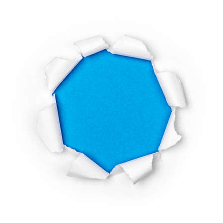 Paper hole in white paper with ragged edges with blue background.