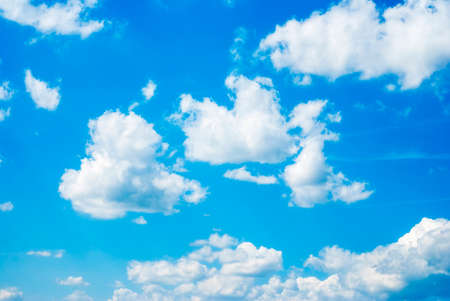 Blue sky background with white fluffy clouds Reklamní fotografie