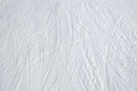 Top view of ski tracks on snow background.