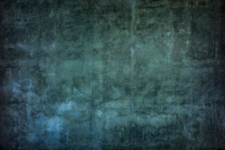Grunge dark aged wall plaster texture background.