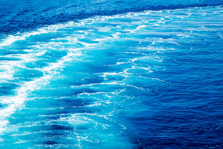 Trail on ocean water surface behind of fast moving powerful ship engines. Reklamní fotografie