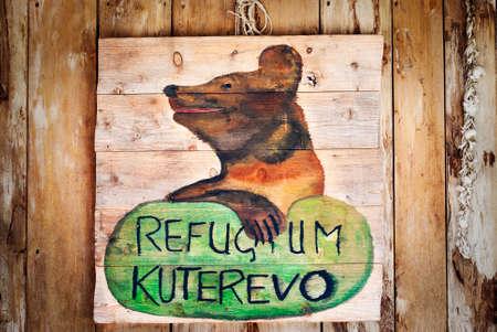 KUTEREVO, CROATIA – AUGUST 19, 2016: Wooden Welcome Sign In Kuterevo – Croatia Bear Refugium.