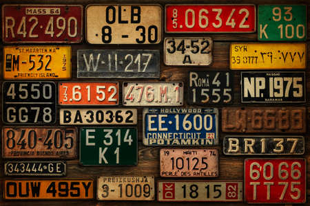 Various retro License Plates on the wooden wall. Redakční