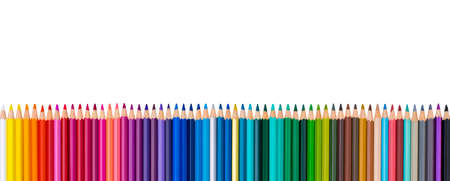 Colored pencils in a row, isolated on a white background.