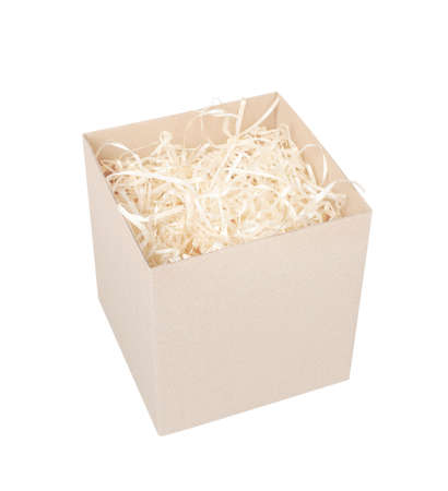 Top view of cardboard box for eco gift filled with decorative shredded white paper / straw. Stock Photo