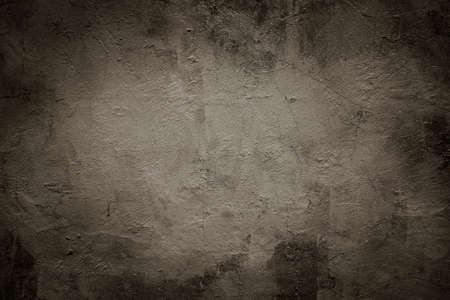 Grunge scratched brown / sepia / gray wall texture background.