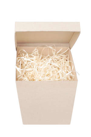 Top view of cardboard box for eco gift filled with decorative shredded white paper / straw with opening lid. Isolated on white.