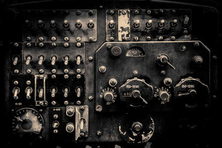 Interior of the old fashioned aircraft glider dashboard of World War II era military transport in black and white. Stock Photo