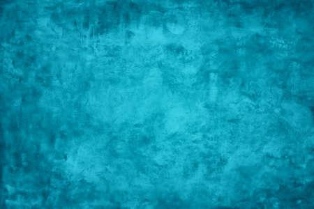 Grunge blue wall texture plaster background.