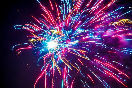 Colorful fireworks display in the dark night sky. Stock Photo