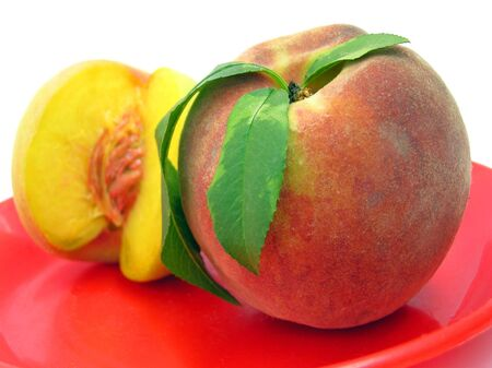 Whole and half peach Stock Photo - 586504