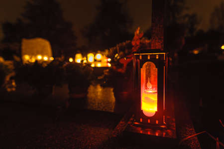 all souls' day: Grave candles on cemetery at night.Deceased holiday in Poland.